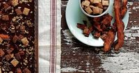 Melt milk chocolate and top with cereal and chopped bacon. Make sure to use Reynolds® Parchment Paper to line your pan!