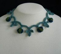 Make a stunning Blossom Necklace like this free crochet pattern. It's lightweight and a great way to use up your leftover yarn. Using a few different stitches you can have this necklace ready to wear in no time.