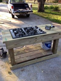 Find a gas range on craigslist or yard sale..turn it into an outdoor