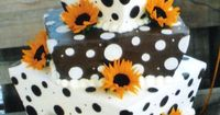 21st birthday cake... lol on a smaller scale of course but it combines two of my fave things... sunflowers and polkadots
