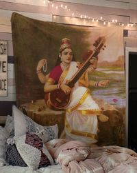 The Hindu god Saraswati with her Sitar and Peacock - Tapestry $35.00