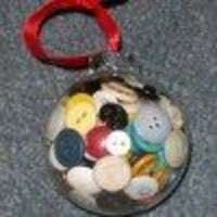 Use up your spare buttons by turning them into a cute Ornament of Buttons. This is one of those easy to make Christmas ornaments that you whip up in a few minut