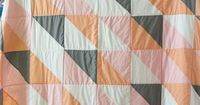 simple triangles. i love this quilt. i love the solids. but even would be cute with my vintage sheet stash