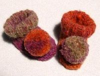 Pom-Pom Baby Booties   AllFreeKnitting.com- Try this free, cute knitting pattern for your baby's next pair of booties. Pom-pom baby booties are a fun alternative to traditional baby booties.