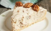 This beautiful butter pecan cheesecake is an awesome alternative to your regular pecan pie. It's light and creamy, yet dense with pecans.