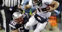 New England Patriots linebacker Rob Ninkovich (50) takes down Denver Broncos quarterback Tim Tebow (15) during the second half of an NFL divisional playoff football game Saturday, Jan. 14, 2012, in Foxborough, Mass.