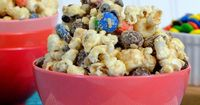 Monster Cookie Dough Popcorn - all the flavors of a monster cookie in a chocolate and Biscoff covered popcorn