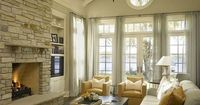 vaulted ceiling builtins | living room with vaulted ceiling, stone fireplace flanked by built ...