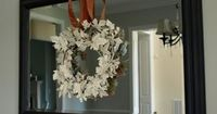 like the indoor wreath on mirror. leave fall leaves or ivory Krylon spray paint for the white treatment