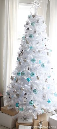 See my Winter Woodland Glam White Christmas tree decorating ideas! Owl ornaments, a glam snowflake tree topper combine rustic nature with glamorous shine!