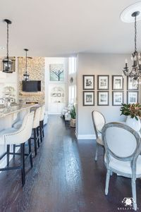 open home floor plan with winter decor from the kitchen into the living room