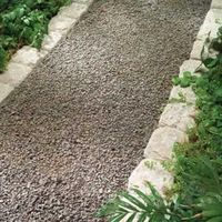 A garden path enhances any backyard. Learn about design factors, limitations and installation techniques for gravel, stone, brick and pavers, along with attract