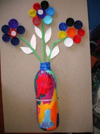 Cute flower project. Use a plastic bottle for the vase and bottle caps for the flower petals. A great recycled craft.