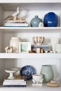 bookshelf styling in cool hues on white