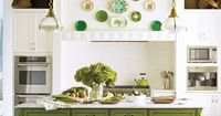 Warm up your kitchen cabinets with a two-tone scheme