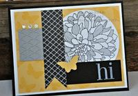 Stamps: Butterfly Collection (wheel), Regarding Dahllias Ink: StazOn, Whisper White Craft CS: Basic Black, Smoky Slate, So Saffron, Whisper White DSP: Modern Medley Accessories: Bitty Butterfly Punch, Big Shot, Fancy Fan embossing folder, Baker&rs...