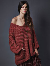 Chunky oversized tunic sweater in a slouchy, effortless fit. Dolman style sleeves with a low neckline and front slip pockets.