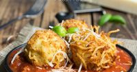 Spaghetti Balls with Meat Sauce! Spaghetti is combined with a cheesy mixture then formed into balls and fried until golden brown, then placed on top of a rich and hearty meat sauce.
