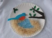 The photo links to a full tutorial on how to make this bird's nest. I'm thinking I might adapt this idea to make a series of different felt birdies that kids can play with and take a picture of their creation then be able to re-use it. I did s...