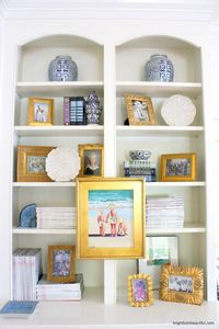 I am fascinated with bookshelf styling. You can tell a lot about a person by the way they style a bookcase. Every trinket tells a story.