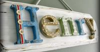 ** Have the letters need paint or put paper on, embellish and put on painted board. Sign using wood letters