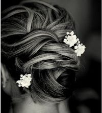 this hairstyle would look really good with your hair if you didn't want to go for the adrian curly side pony look