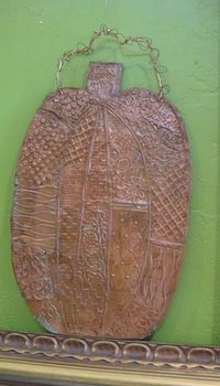 Hand embossed copper pumpkin with patina