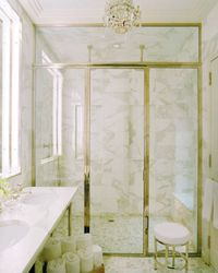 Timeless Combination of Marble, Crystal, and loads of Polished Nickel Hardware and Trim}