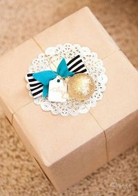 Kraft paper wrap, doily paper on top with gold twine. Rustic but sophisticated.