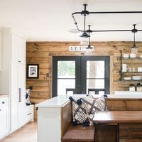 We love this kitchen from last week's reveal! The white cabinets, stained shiplap, black iron details, and built-in booth made this kitchen one of the most unique we've seen! Get ready for an all new Fixer Upper tonight at 9/8 CT on HGTV. #fixer...