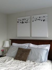 I bought two $22 primed canvases from Blick, a spool of textured charcoal thread, and a foot of charcoal starched linen-like fabric. I cut the gray fabric into 14-18 leaves for each canvas and cut a small slit in the center of each leaf to make room for t...