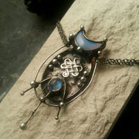 Brass pendant- cosmic octopus with crescent moon from opalite and eye is natural moonstone. Brass Fantasy Pendant $43.00