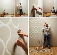 Add the peal-away wallpaper elements to a selected wall surface, decorate with paint on the in-between spaces and pull back the sticky tape-like material to reveal the final design.