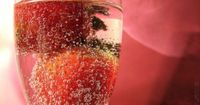 Strawberry Punch Champagne: Ingredients: - 2 Packages 10 ounces each frozen sliced strawberries in syrup, thawed - 2 cans 5-1/2 ounces each apricot or peach nectar - ¼ cup lemon juice - 2 tablespoons honey - 2 bottles 750 ml each champagne or sparkling w...
