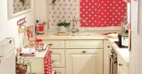Kitchen small but cute.Enough red to make it cute. Enough white to keep it from looking too small. Get creative with storage.