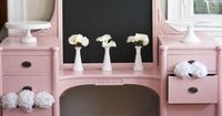 The cake/candy table for the wedding. Love the blackboard paint in the mirror space...could write a quote or list the yummy treats :)