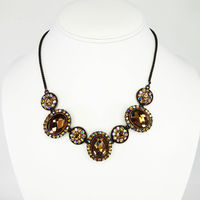 Brown Rhinestone Necklace with Oval and Round Settings Accented with Aurora Borealis Rhinestones and Brownish Copper Chain, Vintage 1990s $30.00